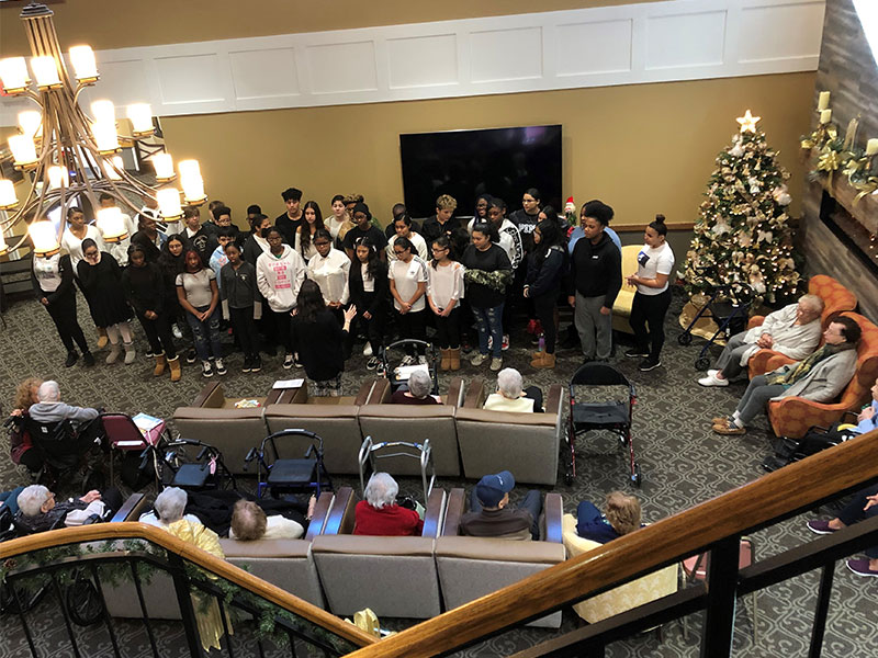 Middle School Chorus Serenades Dominican Village Residents